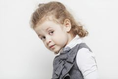 Cute little girl, close-up, light background royalty free stock photography