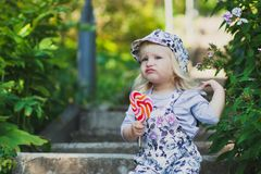 Cute little girl with colorful lollipop royalty free stock images