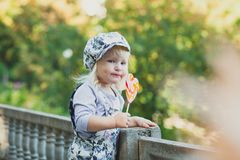 Cute little girl with colorful lollipop stock photo