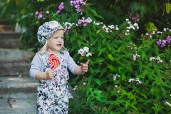 Cute little girl with colorful lollipop stock photography