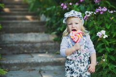 Cute little girl with colorful lollipop royalty free stock photo