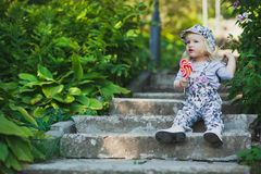 Cute little girl with colorful lollipop royalty free stock photos