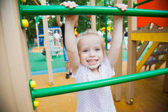 Cute little girl on a colorful playground Royalty Free Stock Photography