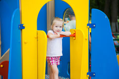 Cute little girl on a colorful playground Stock Photography