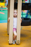 Cute little girl on a colorful playground Stock Photo