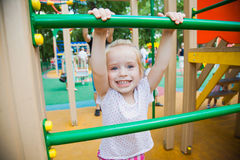 Cute little girl on a colorful playground Royalty Free Stock Images