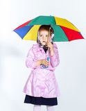 Cute little girl with colorful umbrella Royalty Free Stock Photography