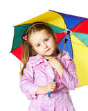 Cute little girl with colorful umbrella Stock Images