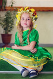 Cute little girl in a costume Stock Images