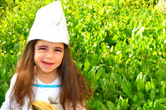 Little costumed girl. Cute little girl costumed with beautiful green background of plants Royalty Free Stock Image