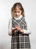 Cute little girl counting fingers against white background Stock Image