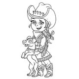 Cute little girl in a cowboy costume playing with a dog outlined Stock Photo
