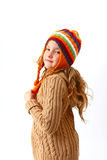 Cute little girl in cozy clothes isolated on white background Stock Photo