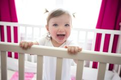 Cute little girl in cradle at baby room Royalty Free Stock Photography