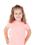 Cute little girl with crossed arms smiling Royalty Free Stock Photography