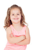 Cute little girl with crossed arms smiling Stock Photography