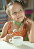 Cute little girl with cup Royalty Free Stock Image