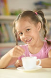Cute little girl with cup Stock Images
