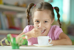 Cute little girl with cup Stock Photos