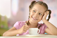Cute little girl with cup Stock Photo