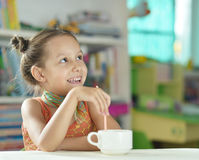 Cute little girl with cup Royalty Free Stock Photos