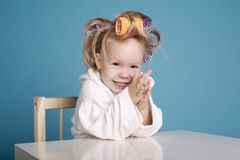 Cute little girl with curler Royalty Free Stock Image
