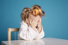 Cute little girl with curler Stock Image