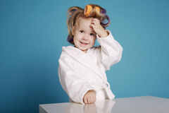 Cute little girl with curler Stock Photo