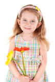 Cute little girl with daisies Stock Image