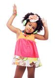 Cute little girl is dancing in headphones royalty free stock photos