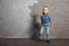 Cute little girl dancing, jumping, smiling and posing to camera. Cute little girl posing joyfully to camera. Dancing, jumping, running, laughing. Vintage Stock Image