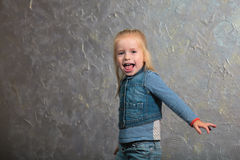 Cute little girl dancing, jumping, smiling and posing to camera Royalty Free Stock Photography