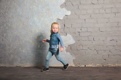 Cute little girl dancing, jumping, smiling and posing to camera. Cute toddler girl posing joyfully to camera. Dancing, jumping, running, laughing. Vintage Royalty Free Stock Photos