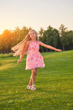 Cute little girl dancing outdoors. stock image