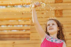 Cute little girl with dandelion flower. Happy childhood concept Stock Images