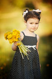 Cute little girl with dandelions Royalty Free Stock Photos