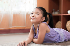 Cute little girl day dreaming. Stock Photos