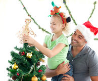 Cute little girl decorating the christmas tree Royalty Free Stock Images