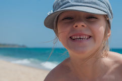 Cute little girl in denim cap Stock Images