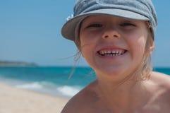 Cute little girl in denim cap Stock Images