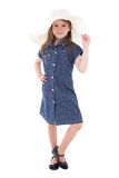 Cute little girl in denim dress and big summer hat isolated on w Royalty Free Stock Photo