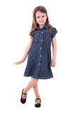Cute little girl in denim dress posing isolated on white Royalty Free Stock Photos