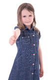 Cute little girl in denim dress thumbs up isolated on white Stock Image