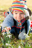 Cute little girl discover snow drops Stock Photo