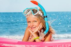 Cute little girl diver having rest at the seaside Stock Images