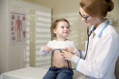 Cute little girl and doctor Stock Images