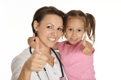Cute little girl at doctor Stock Images