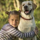 Cute little girl with a Dog. Love. Stock Photos