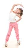 Cute little girl doing gymnastic exercise Stock Photos