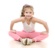 Cute little girl doing gymnastic exercise Royalty Free Stock Image
